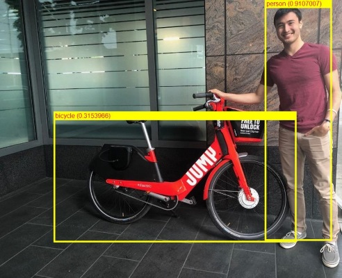 ML.NET detected a man and a bike in the photo, using ONNX